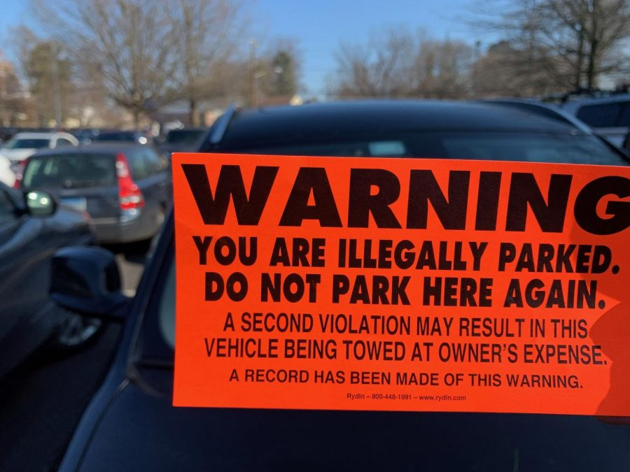 Many+students+received+notices+that+their+cars+would+be+towed+due+to+parking+without+a+permit+in+the+main+parking+lot.+The+increase+in+prohibited+parking+came+as+a+result+of+the+snow+from+Jan.+14+blocking+parking+spaces+in+both+the+main+lot+and+baseball+field+parking.