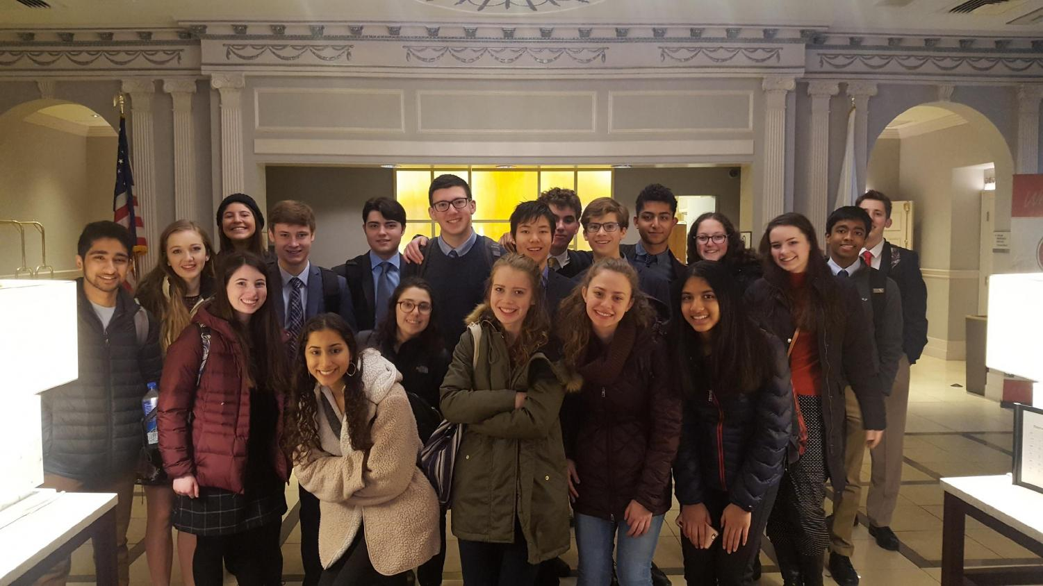 The public forum team poses for a picture at the hotel before going to rounds. The Harvard Tournament is traditionally freshmen's first exposure to traveling with the team. Photo courtesy Ethan Singer.