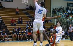 Boys basketball defeats Wheaton 69–57 in first playoff matchup