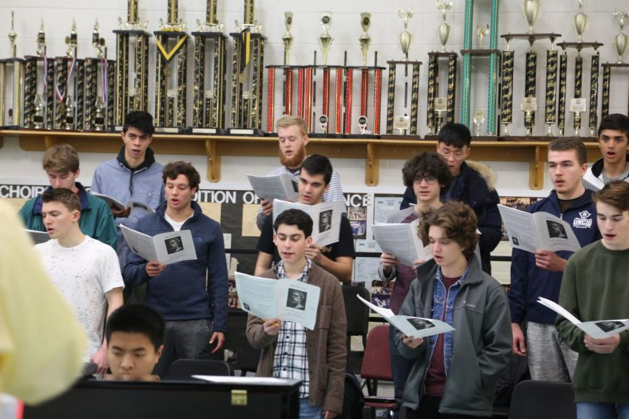 Choral+director+Jeffery+Davidson+leads+men%27s+chorus+through+a+piece.+Whitman%27s+men%27s+chorus+is+an+award-winning+ensemble+composed+of+44+boys.