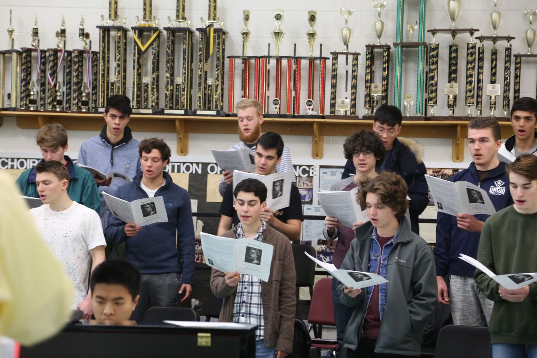 Choral director Jeffery Davidson leads men's chorus through a piece. Whitman's men's chorus is an award-winning ensemble composed of 44 boys.