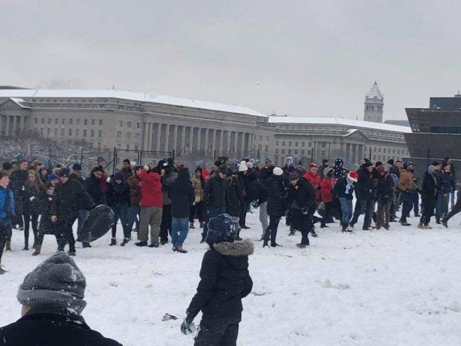 The+D.C+snowball+fight+association+gathers+on+the+Washington+Mall+Jan.+13+to+pelt+one+another+with+snowballs.+The+DCSFA+was+founded+in+2009%2C+and+people+of+all+ages+attend+events.
