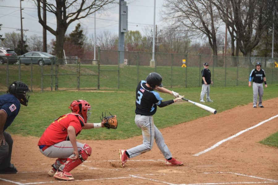 Shortstop+Matt+Ryan+makes+contact+with+the+ball+while+at+bat.+Ryan+had+four+RBI%27s+in+the+Vikes%27+shutout+win+over+Wheaton.+Photo+by+Joey+Sussman.+