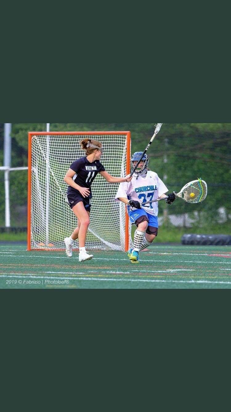 Attacker Abby Waldvogel plays close defense against the Churchill goalie in the Vikes 12–11 win against the Churchill Bulldogs in the third round of the playoffs. Photo courtesy of Phil Fabrazio.