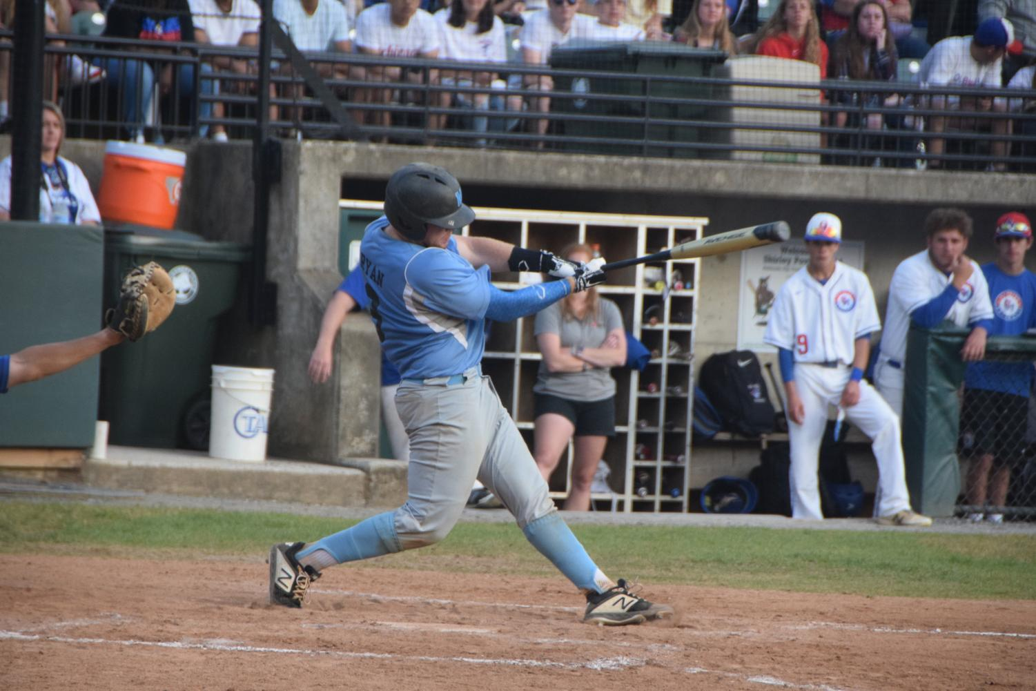 Catcher Jack Ryan swings and crushes a home run in the baseball teams 4–3 loss to the Old Mill Patriots in the state semi-finals. Photo courtesy of Joey Sussman.