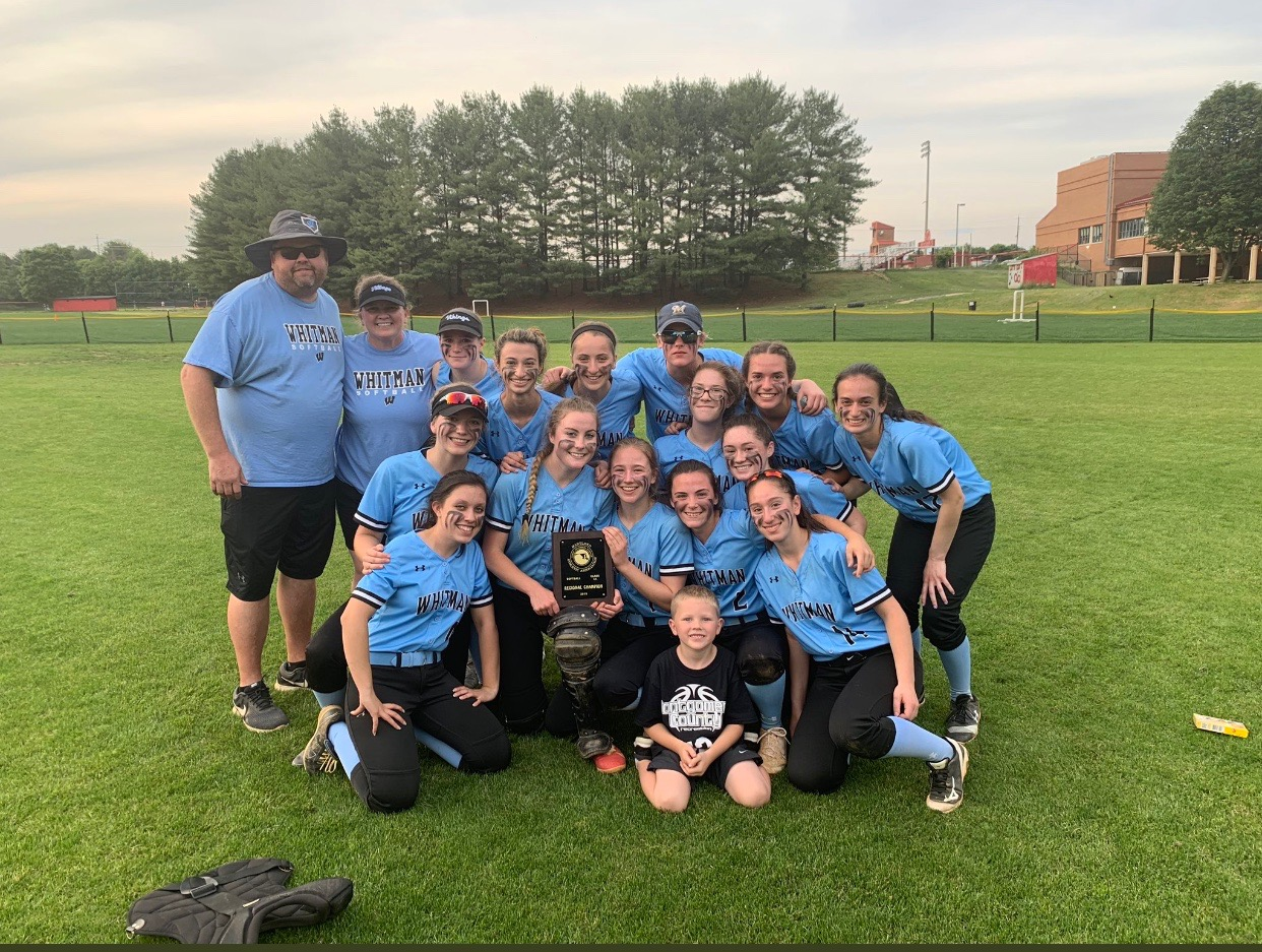 The softball team celebrates their first ever regional championship win over the Quince Orchard Cougars. Photo courtesy of the Whitman Sports Twitter.
