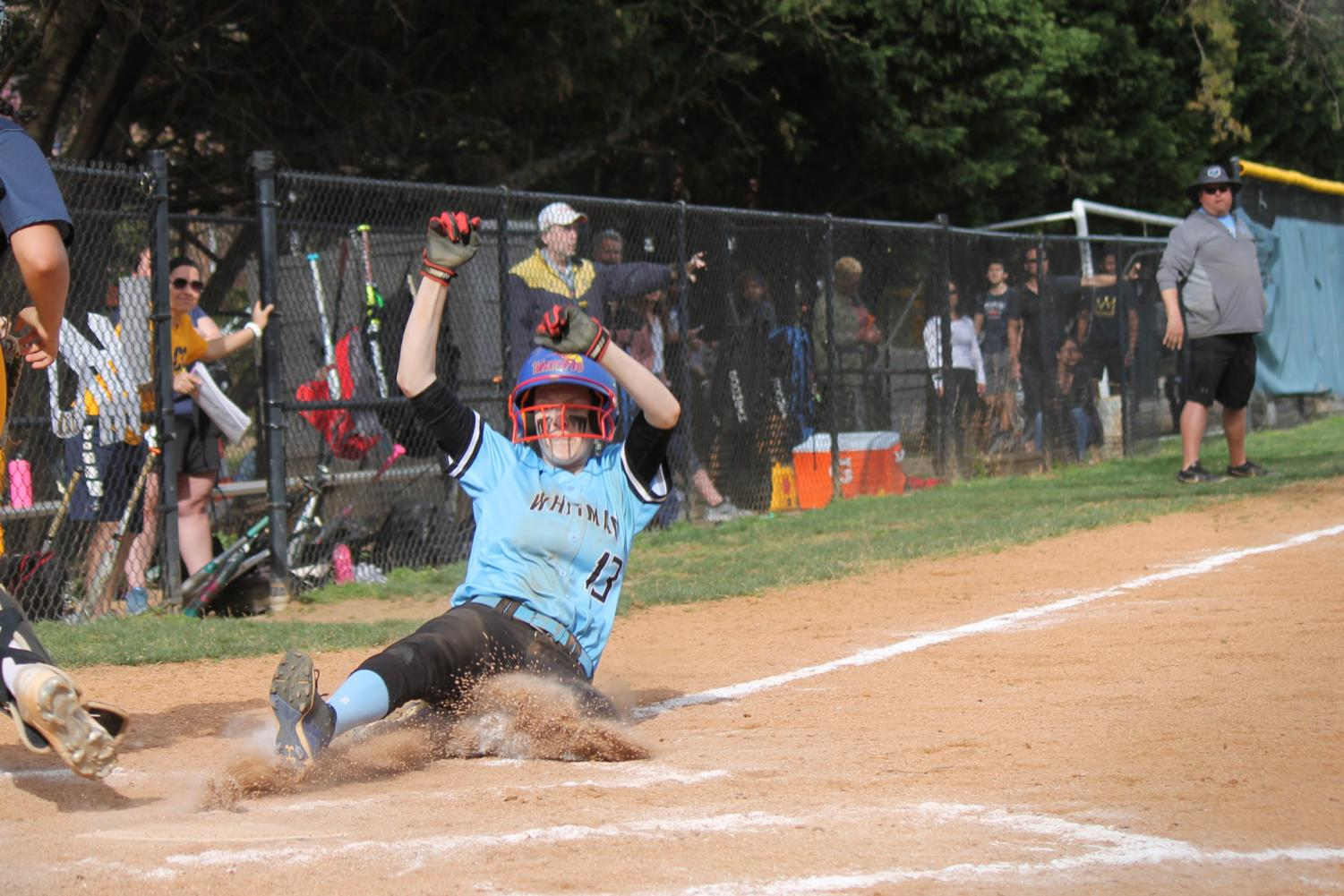 Senior Anna Koretsky slides into home base on a close play to score a run for the Vikes during their game against the B–CC Barons. I followed the team the week of April 9-13 to find out what has made them so successful this year.