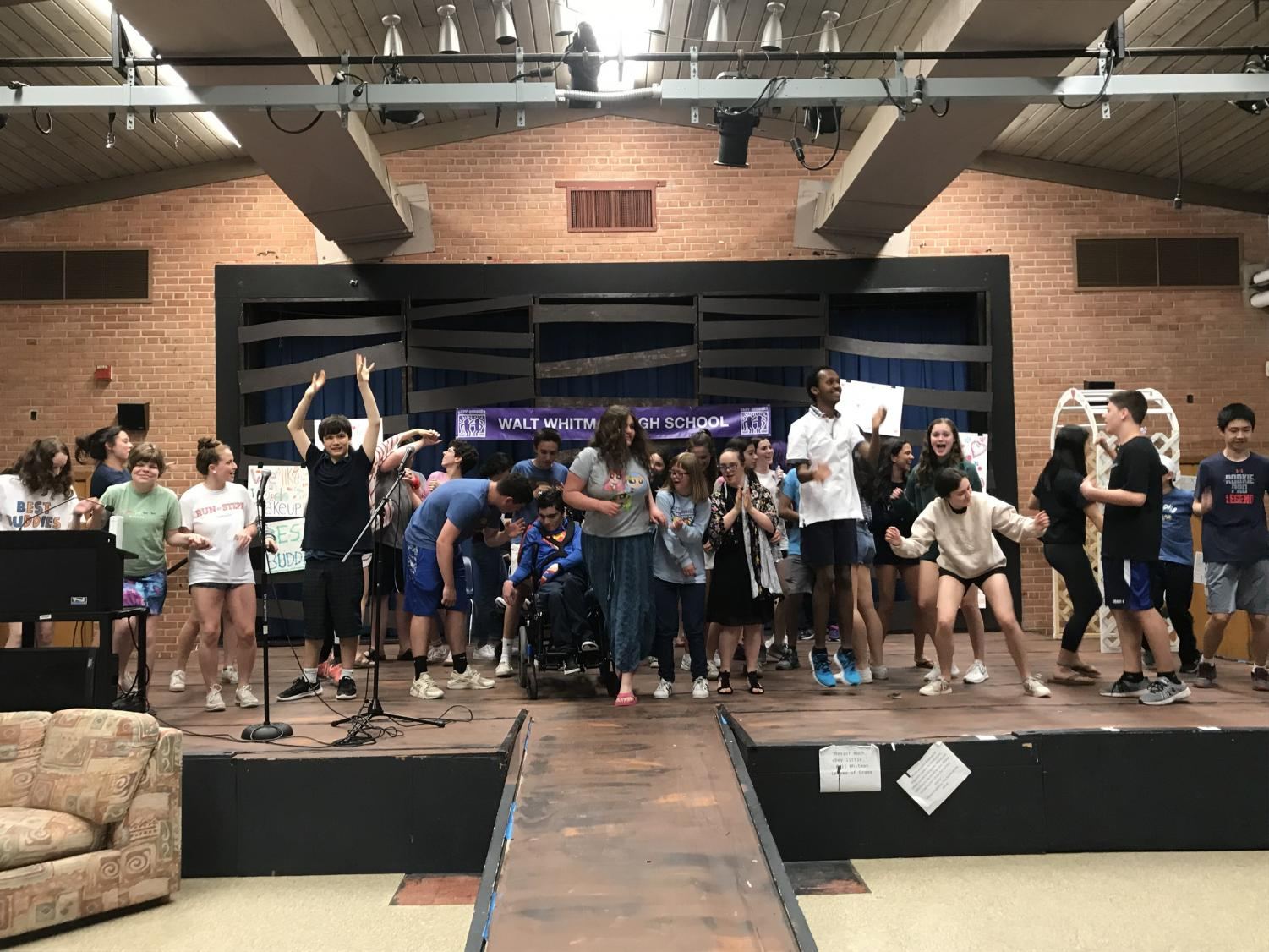 Best Buddies talent show participants celebrate with a dance party. The talent show featured 15 acts from groups of three to five performers.