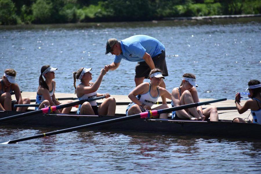 Crew+coach+Kirk+Shipley+fist+bumps+senior+Alexa+Lyman+before+a+race.+Shipley+earned+WaPo+All-Met+girls+crew+Coach+of+the+Year.+Photo+courtesy+ALEXA+LYMAN.