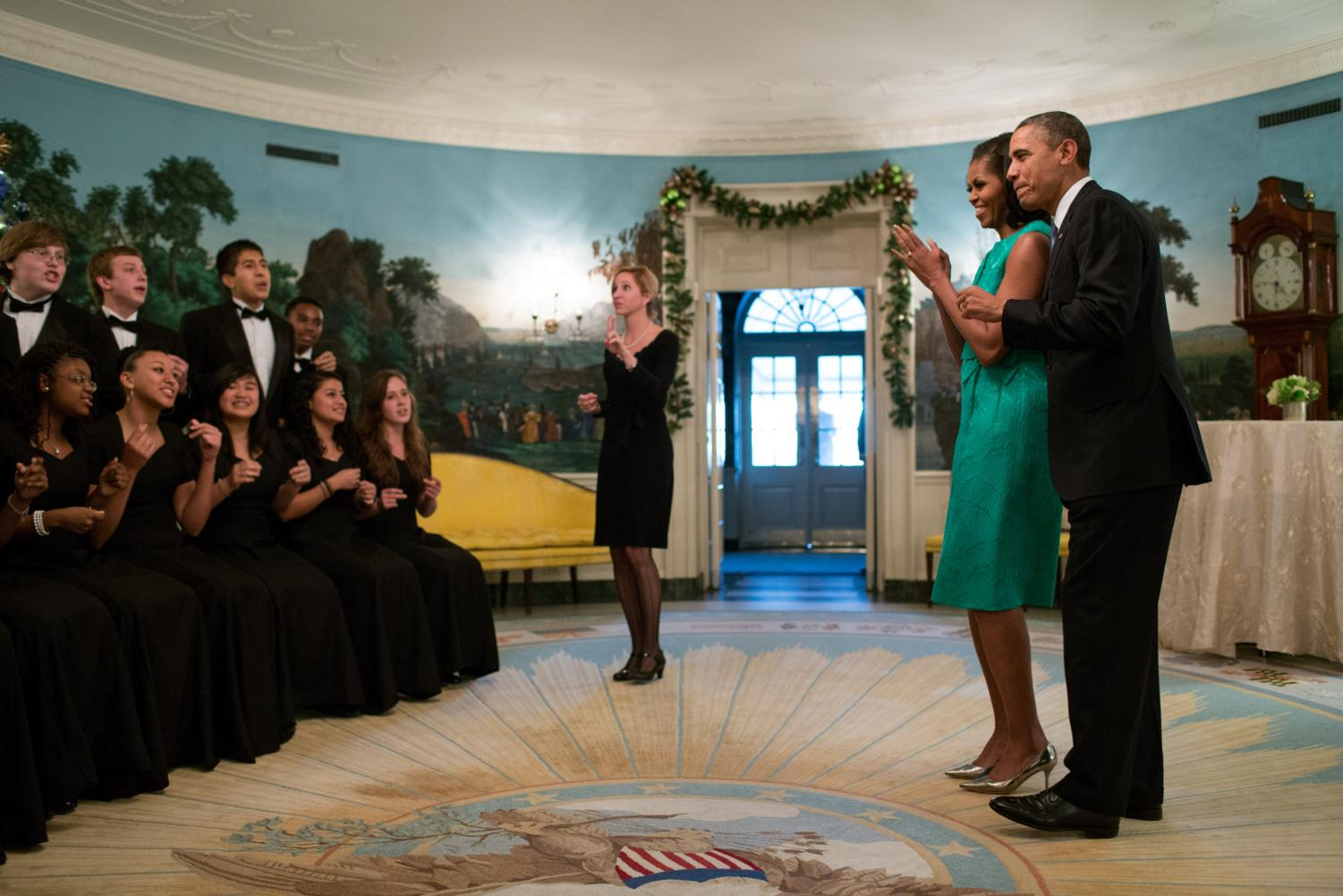 Michelle Searle Kim conducts her Seneca Valley choral students in a performance at a private holiday party at the White House. Next year, Kim will replace Jeffrey Davidson as Whitman's choral director.