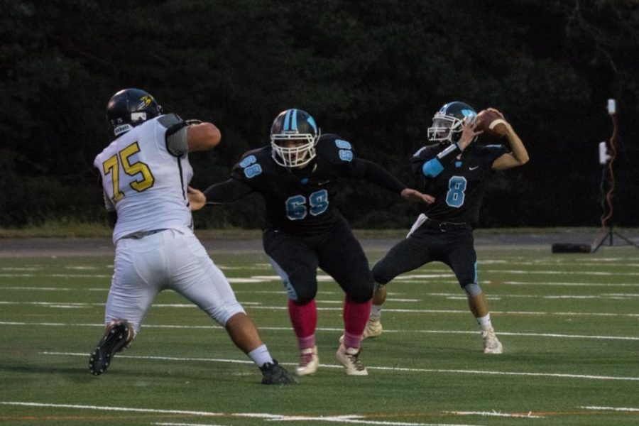 Quarterback+Carson+Robinson%E2%80%99s+winds+up+to+throw+a+pass+during+a+home+game.+Next+year%2C+the+football+season+will+have+nine+games+instead+of+10.+Photo+courtesy+Katherine+Luo.