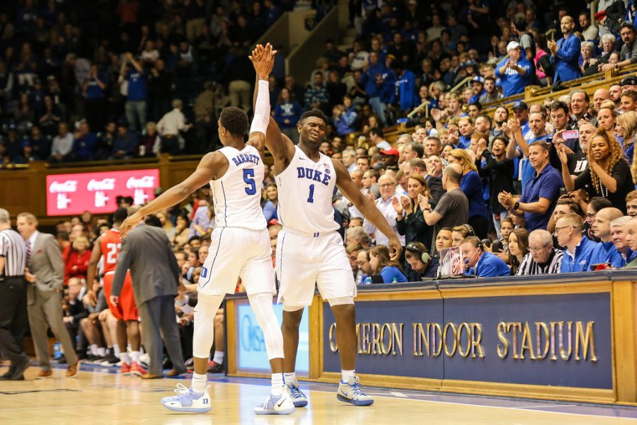 Duke+University+forward+Zion+Williamson+and+guard+RJ+Barrett+high+five+during+a+home+game+this+past+season.+Williamson+and+Barrett+are+both+highly+anticipated+picks+in+the+2019+NBA+draft.+