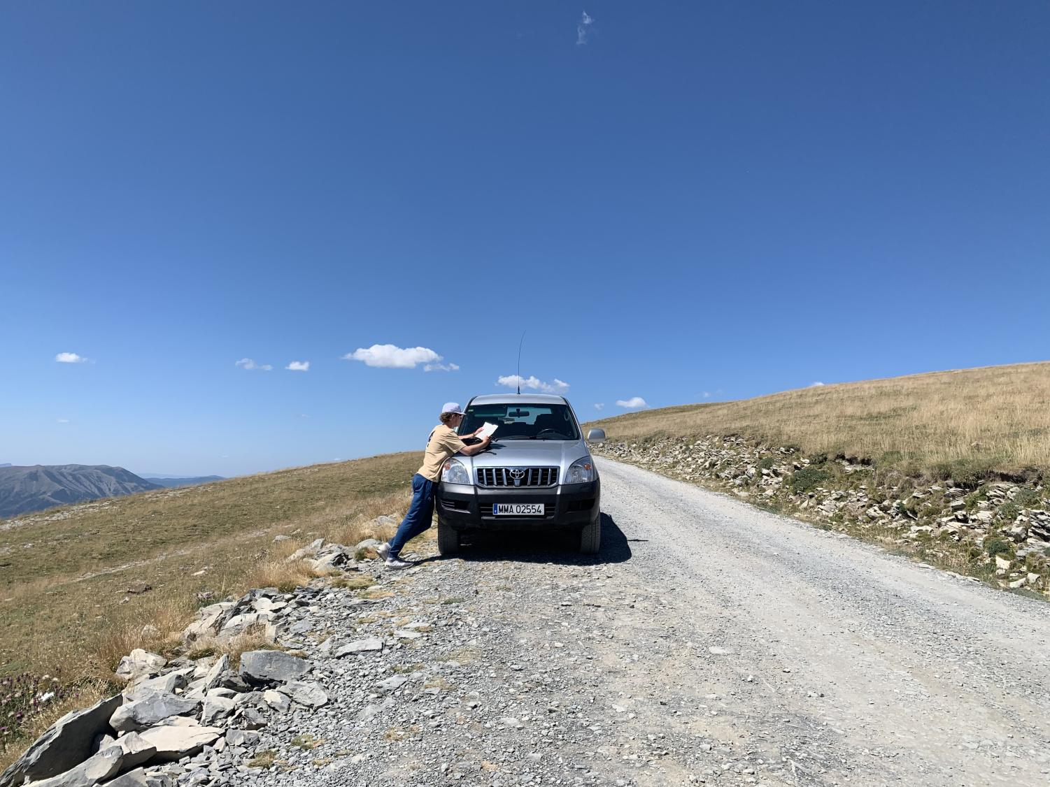 Eli+Putnam+completes+his+summer+reading+at+high+altitude.+He+was+recovering+from+a+long+day+of+hiking+in+the+Pyrenees+Mountains+with+members+of+the+Spanish+Park+Service.