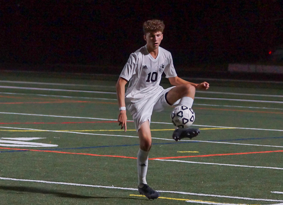 Winger Harmond Cohen receives a pass in the boys soccer team's 1–0 overtime win against the B–CC Barons. Photo courtesy of Sos Mboijana.