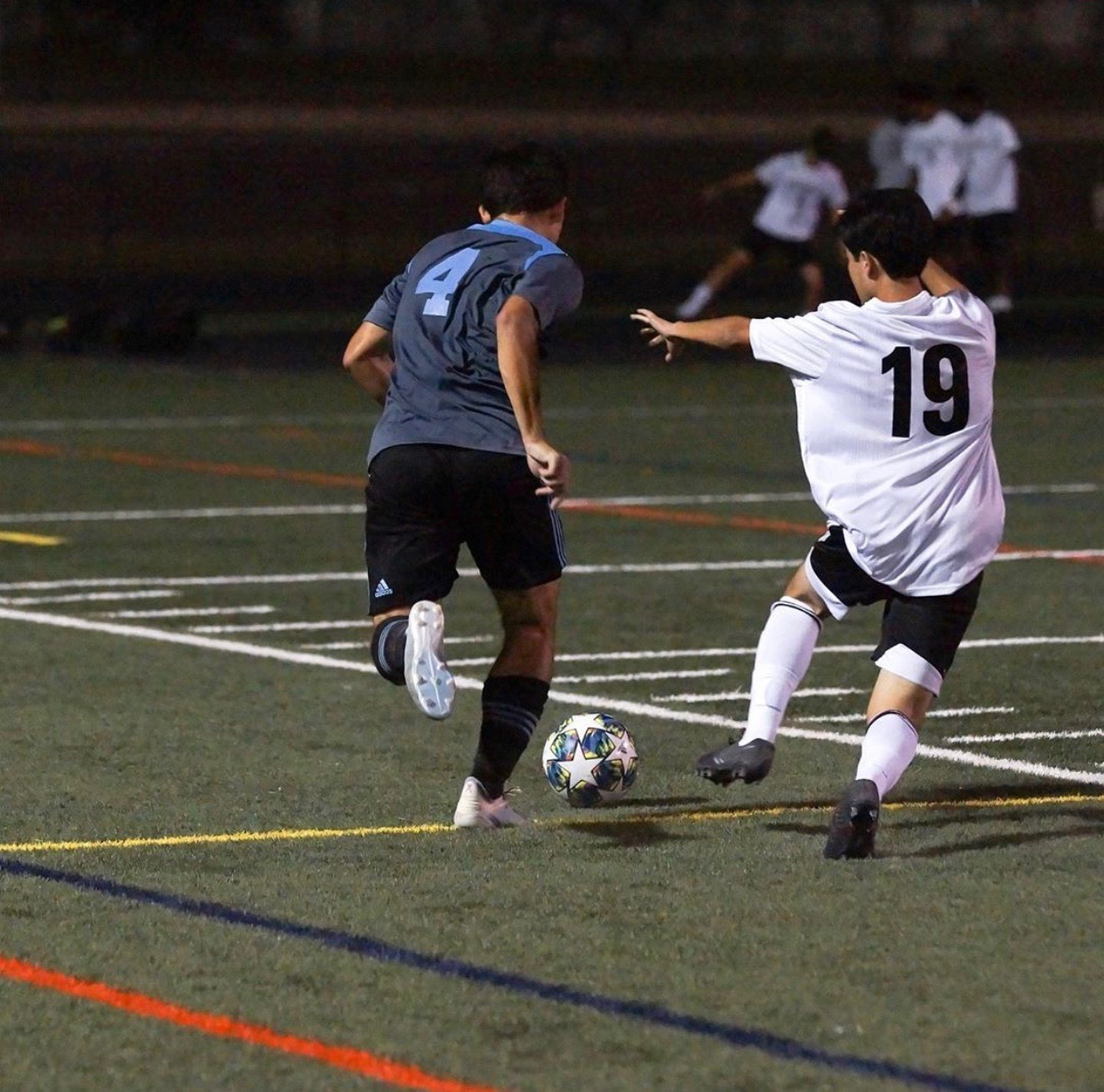 Centre-back Hunter Lee dribbles past a defender in the Vikes 5–0 win over the Wheaton Knights. Photo courtesy of the Whitman Men's Varsity Soccer Instagram.