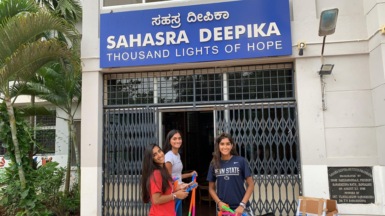 Print+Copy+Editor+Meera+Dahiya+assembles+hula+hoops+with+senior+Saira+Rathod+and+sophomore+Aanya+Rathod+at+Sahasra+Deepika+Foundation+for+Education+in+Bangalore%2C+India.+Dahiya+and+Rathod+spent+three+years+raising+money+to+built+a+sports+court+at+the+school.+