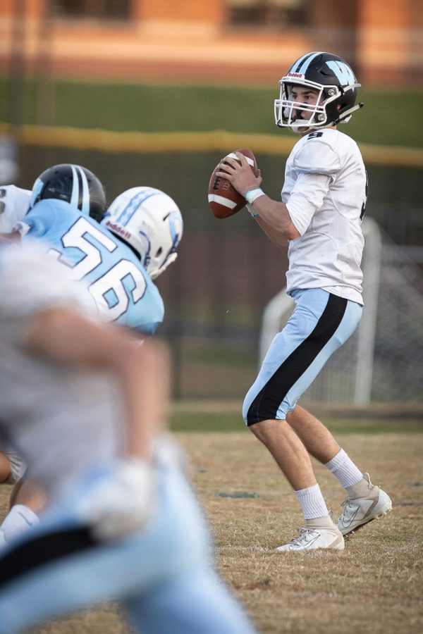 Quarterback Spencer Jones stands in the backfield looking to throw the ball in the Vikes 14–0 loss to Clarksburg. Photo courtesy of Charlie Sagner.