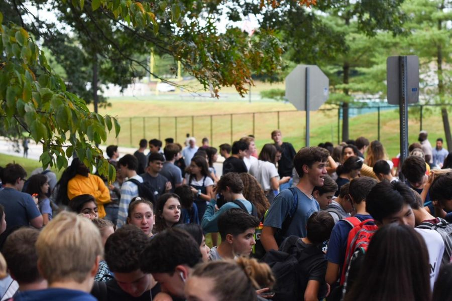 Students evacuate after a fire alarm on Monday. Before the evacuation, a student assaulted another student, though the two incidents were unrelated.