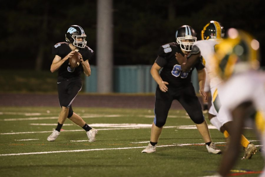 Quarterback Luke Trainor drops back to throw a pass in the football teams 18–7 loss to Seneca Valley. Photo courtesy of Charlie Sagner.