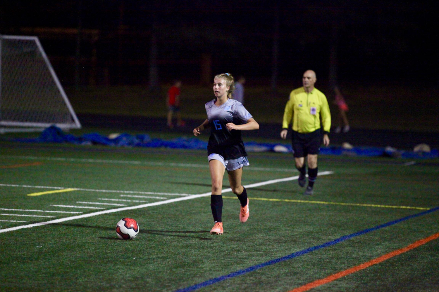 Defender Lexi Fleck dribbles the ball up the field in the girls soccer teams  5–1 win against the Einstein Titans. Photo courtesy of Bill James.