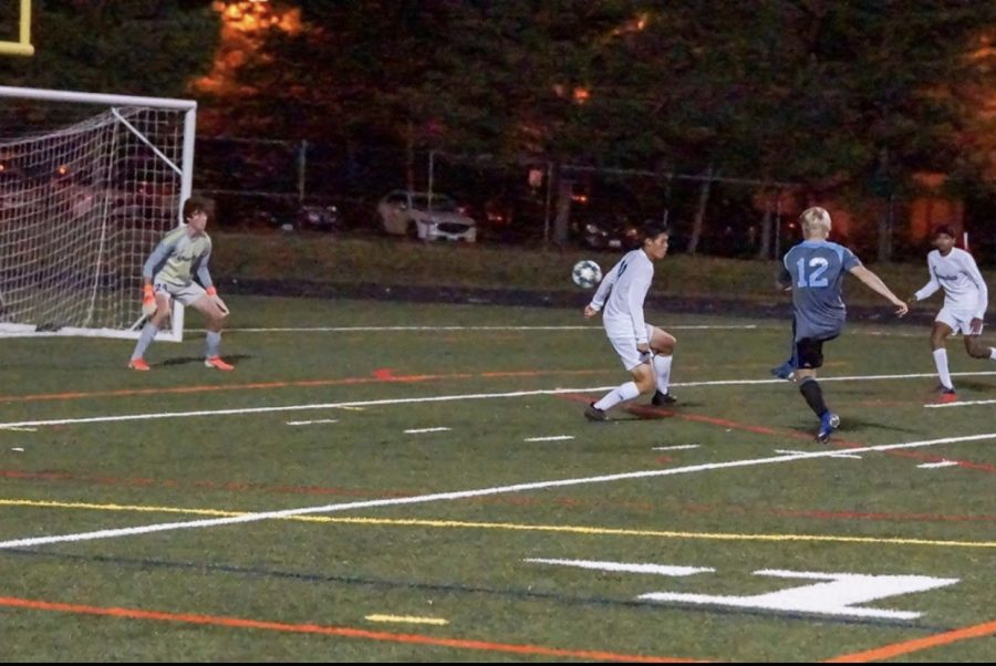 Striker Chris Vogel shoots a shot in the boys soccer teams 7–0 win over the Churchill Bulldogs. Photo courtesy of the Whitman Mens Varsity Soccer Instagram.