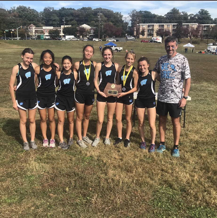 The girls varsity cross country team poses with the first place trophy in the county championships. Photo courtesy of the MCPS Athletics Twitter.