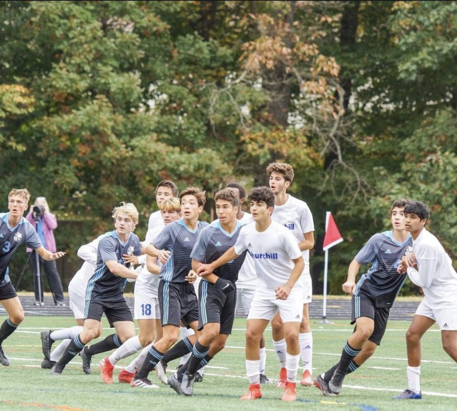The boys soccer teams runs to attempt to strike a free kick in the teams 5–0 win over Churchill. Photo courtesy of the Whitman Mens Varsity Soccer Instagram.