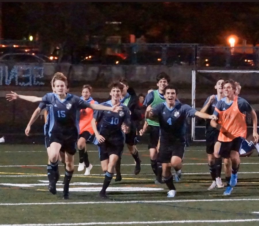The boys soccer team celebrates the game winning goal by running over to the student section in the teams 2–1 overtime win over B–CC in the regional final. Photo courtesy of the Whitman Mens Varsity Soccer Twitter.