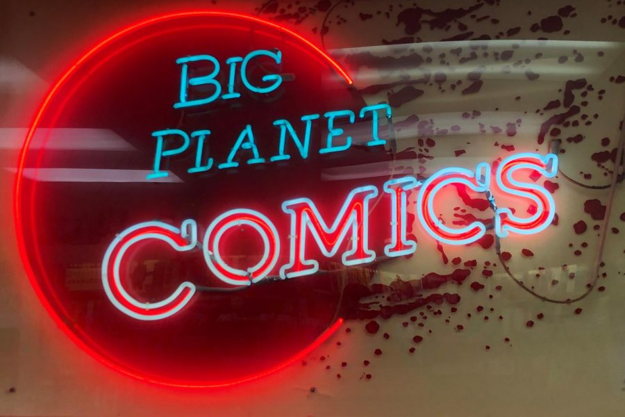 The Big Planet Comics sign shines bright in the Bethesda store. Big Planet is one of the most prominent comic book store chains in the DMV.