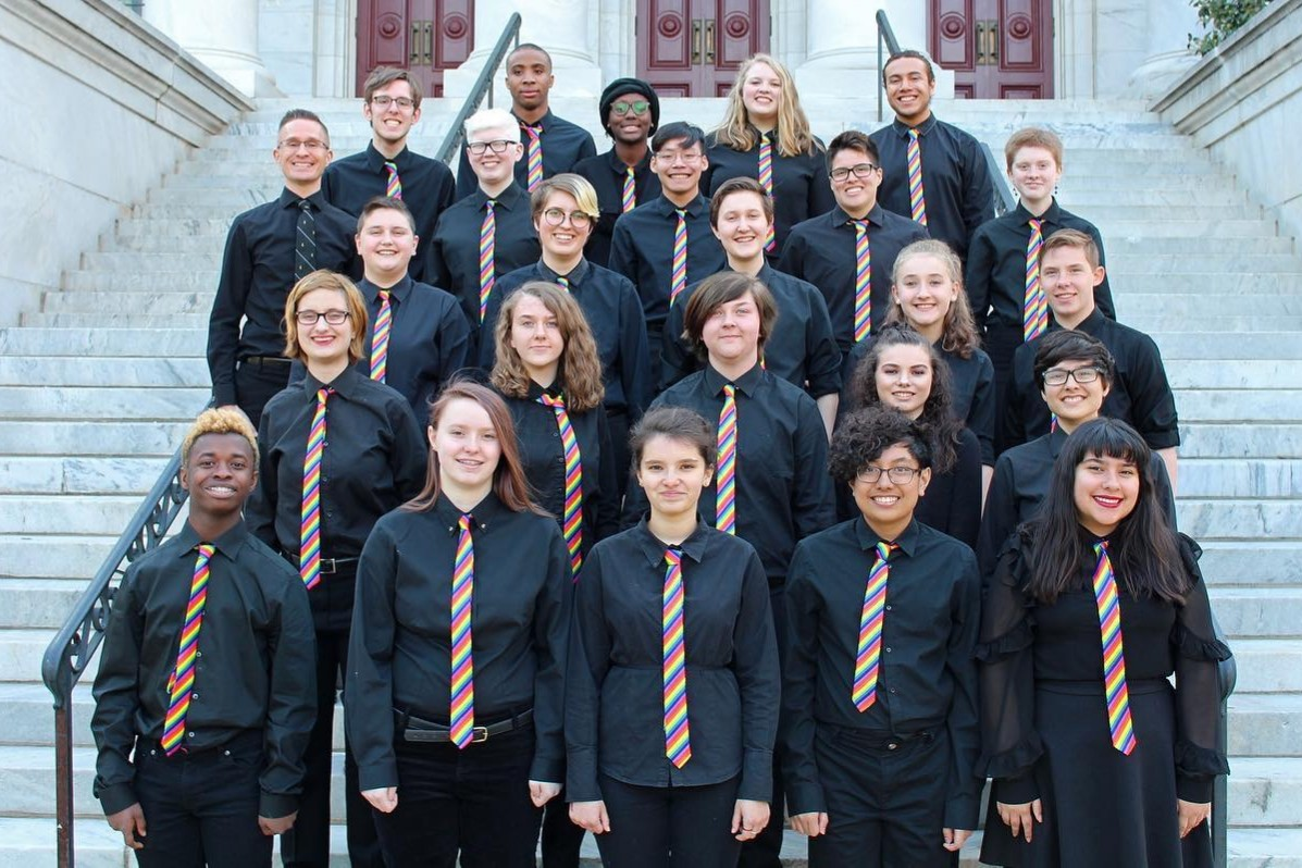 The members of the 2018-2019 GenOUT chorus pose wearing their concert attire.