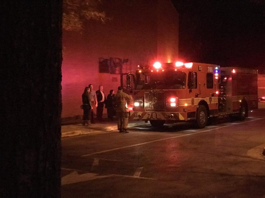 A fire truck arrives at Whitman as Hunchback company members and attendees wait outside. Fog machines triggered the fire alarm, delaying the show's opening night halfway through act one.