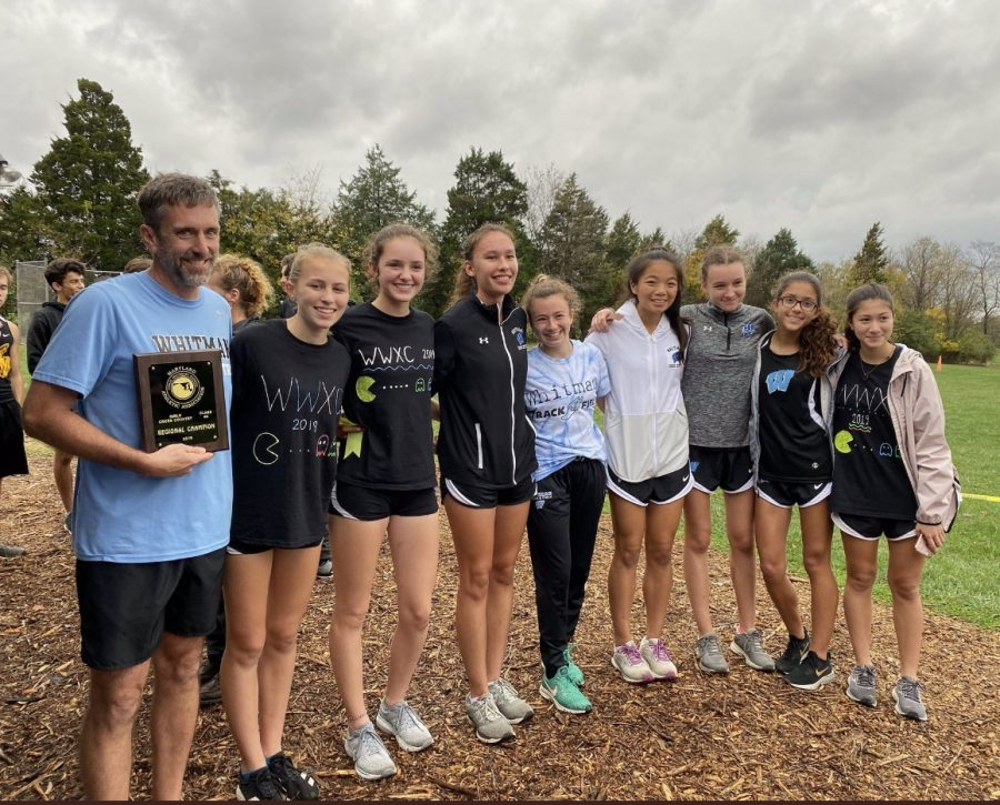 The girls Cross Country team poses with the 4A West Regional Championship trophy after placing first in the race. Photo courtesy of Stephen Hays Twitter.