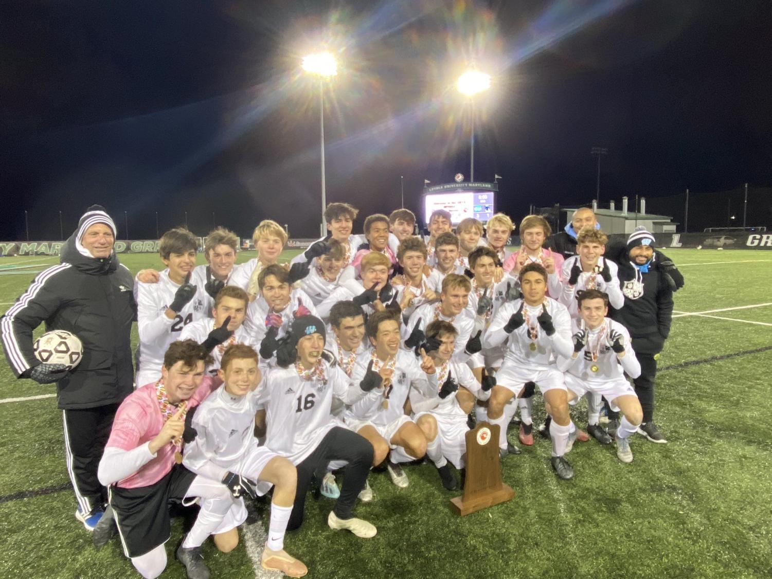 The Vikes pose after the game with the State Championship trophy. The team defeated the Leonardtown Raiders to secure Whitman's eleventh boys soccer state title.