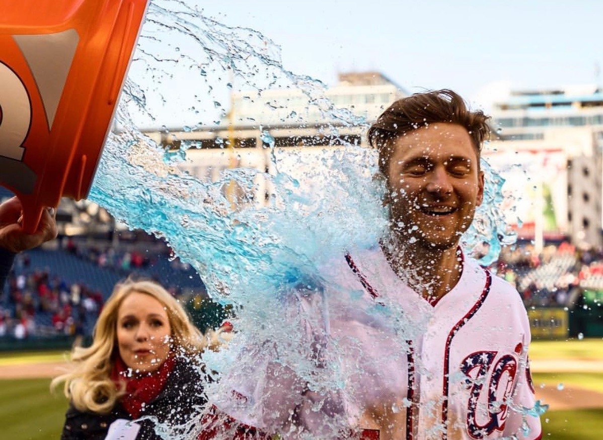 Alex Chappell watches as Nationals' shortstop Trea Turner gets soaked after hitting a walkoff homerun in the Nats' first win of the season.