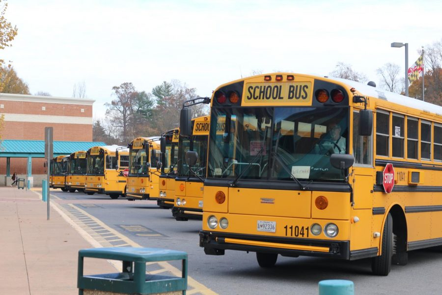 Busses+line+up+outside+the+main+entrance+before+the+last+bell.+MCPS+will+phase+in+new+school+buses+with+seat+belts+over+the+next+12+years.