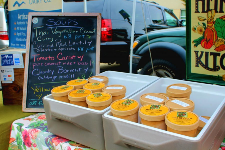 Vegetarian and vegan soups packaged in compostable containers displayed at Heirloom Kitchen.