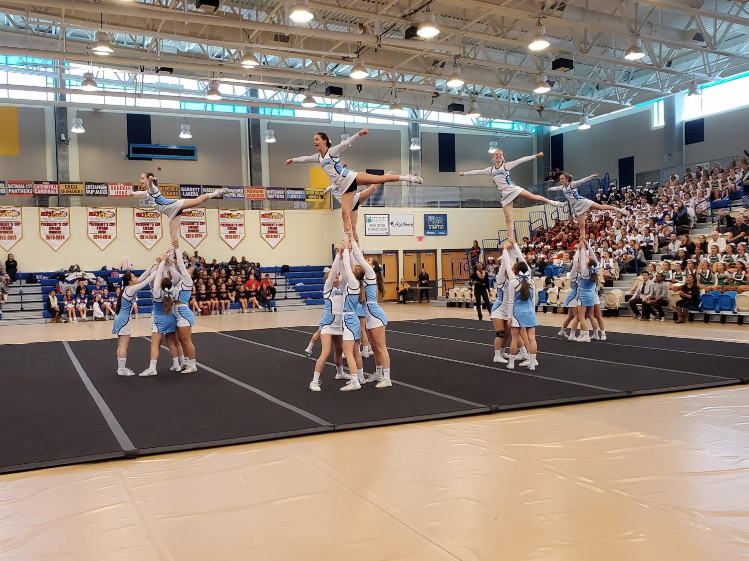 The cheer team performs at the state semifinals on Saturday. The team scored 112.1 points without a single point deducted, and placed 11th out of 26 teams. Photo courtesy the Whitman Cheer Twitter.