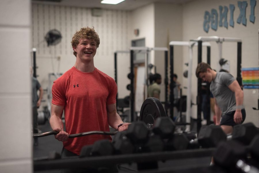Jordan Maggin smiles as he lifts during lifting club on Tuesday afternoon.