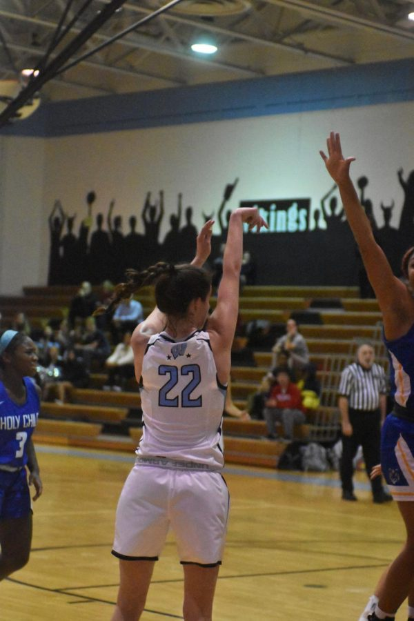 Forward Carter McGloon shoots a jump shot in the girls basketball teams 42–41 loss to Holy Child. Photo courtesy of Kaya Ginsky.