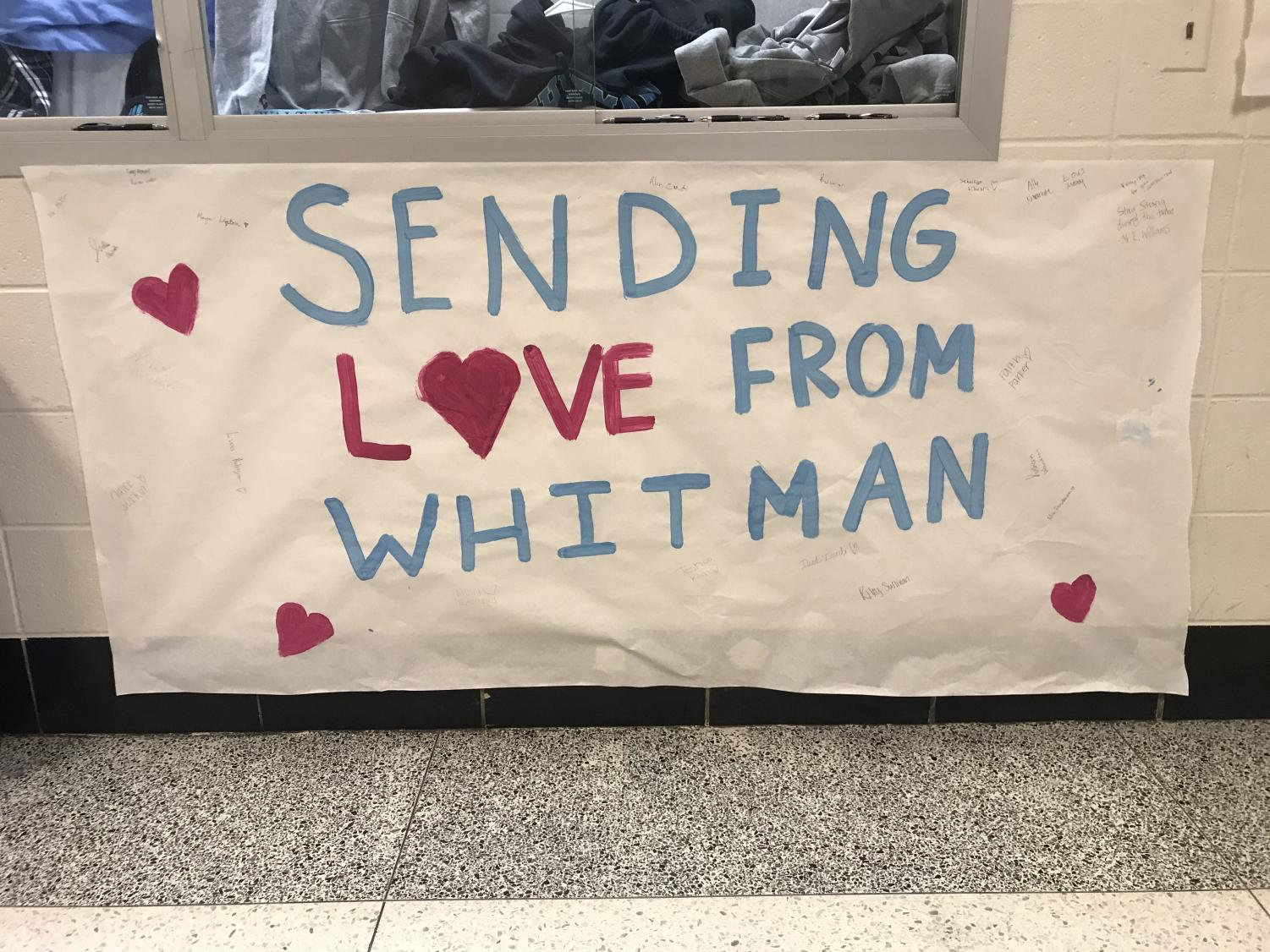 A poster hangs in the main hallway with signatures from Whitman students sending their support. The poster will be sent to Bradley Hills Elementary School for the students in mourning.