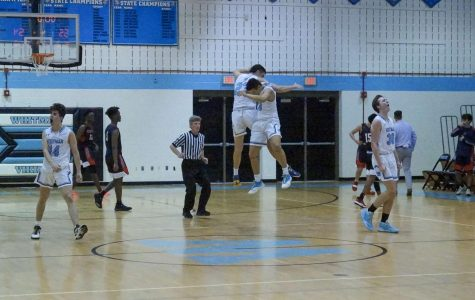 Boys basketball hangs on to defeat Wooton 55–54 in overtime