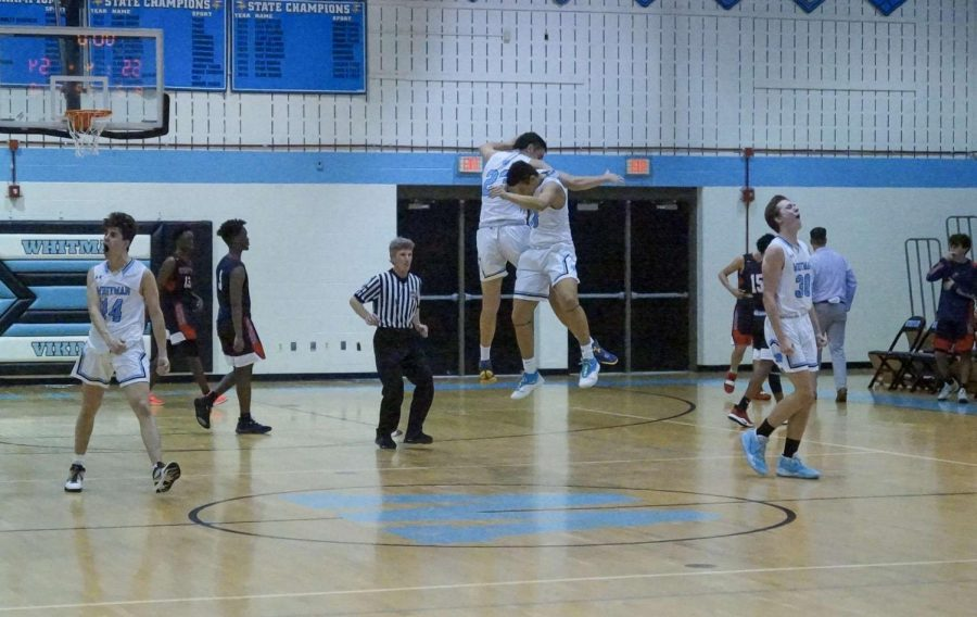 Forward Mark Dimitrov and guard Justin Niles celebrate the boys basketball teams 55–54 overtime win over Wootton. Photo courtesy of Sos Mboijana.