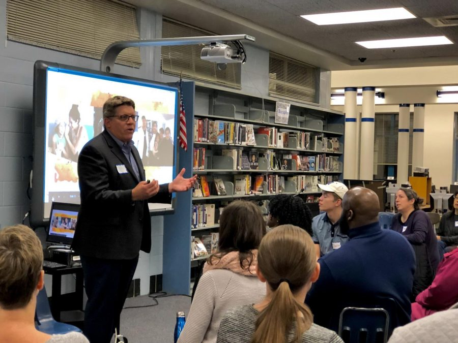 MCPS Equity Initiative Unit member John Landesman introduces himself to a group of parents at a Parent Equity and Race meeting Dec. 17. The event was created in hopes to educate parents on how to lead meaningful and respectful conversations on race.