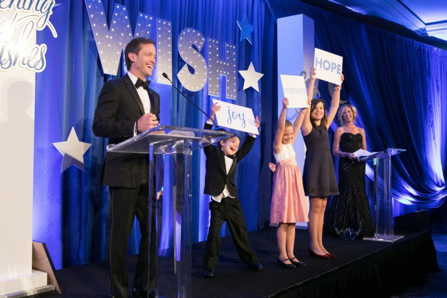 Mike+Manatos+and+his+children%2C+including+freshman+Sienna%2C+inspire+courage+at+a+Make-A-Wish+Gala.+Manatos+loves+to+get+his+family+involved+with+the+foundation+any+way+he+can.