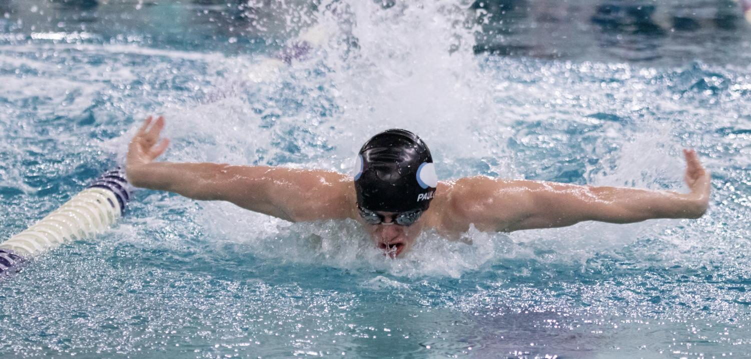 Senior captain Michael Paulos swims the butterfly in the swim and dive team's divisional meet.