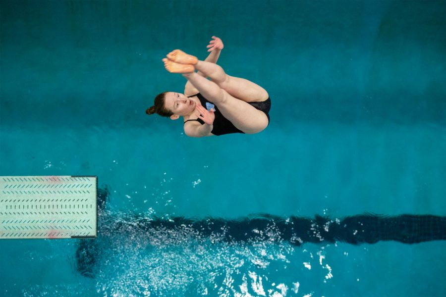 Senior Hannah Donner mid-dive. Donner has been diving since she was nine, diving for her summer team.