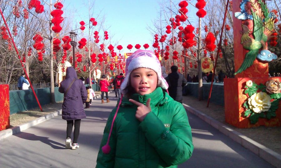 In 2012, Lily Yin poses at the Beijing fair the day after Chinese New Year.