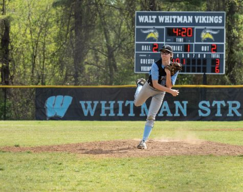 I make one of my few pitching appearances on the Whitman JV Baseball team.