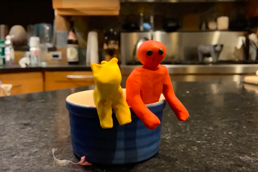 A yellow clay cat and a red clay man stand in a bowl. I wanted to challenge myself and rediscover my passion for claymation, so I directed my own claymation movie.