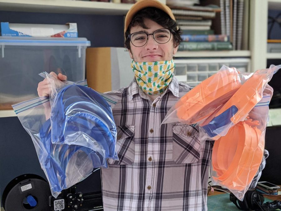 Junior Ezra Bird uses his 3-D printer to make face shield brackets. Bird is one of several Montgomery County students working to fight the pandemic.